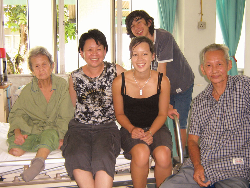 Julie, her children and her biological parents at the West Section women's ward.
